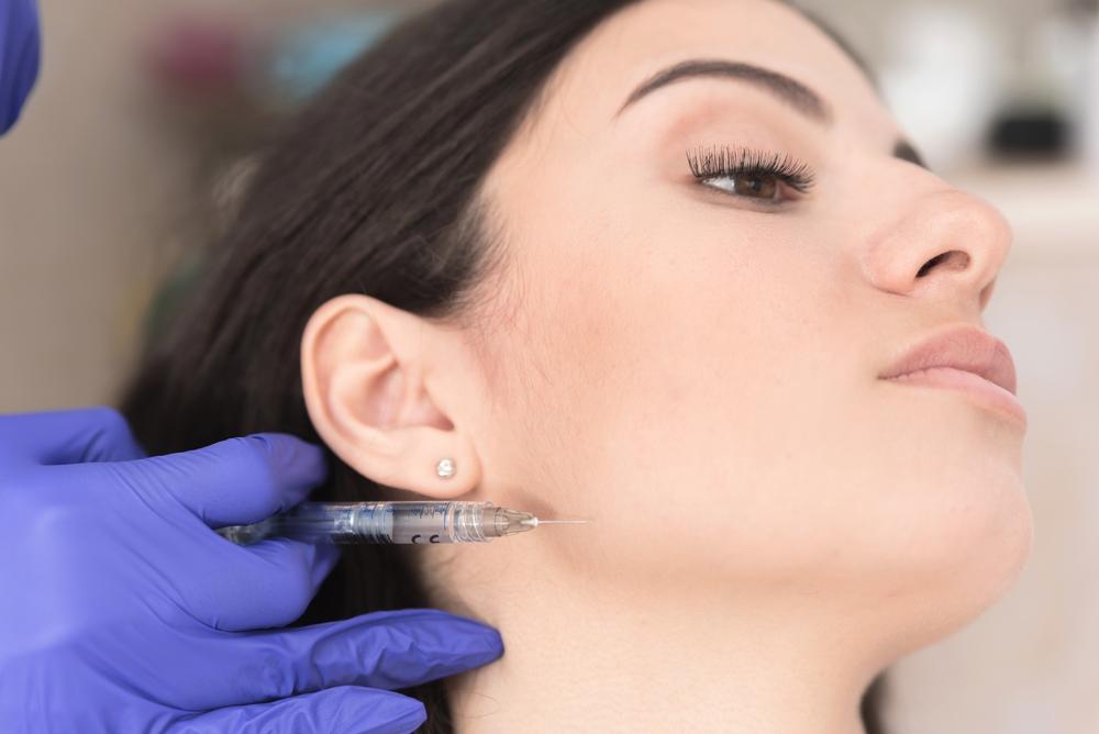 Woman having corrective aesthetic procedure