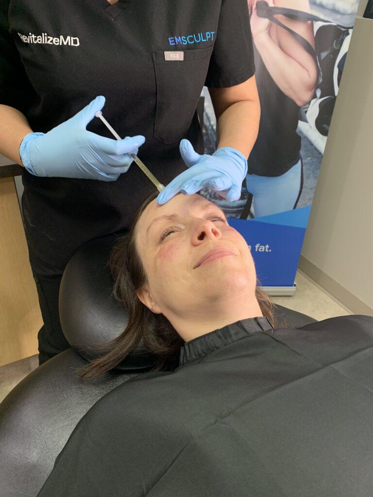 Female patient undergoing a Platelet-Rich Plasma treatment